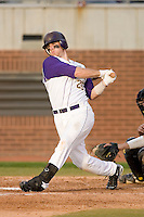 Stephen Batts #25 of the East Carolina Pirates follows through on his swing versus the Elon Phoenix at Clark-LeClair Stadium March 29, 2009 in Greenville, North Carolina. (Photo by Brian Westerholt / Four Seam Images)