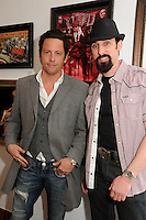"ROSS McCALL & PAUL J. ALESSI  .James Owens ""Savage Beauty"" Art Show Opening Night held at Gasoline Gallery, El Segundo, California, USA>.April 10th, 2010.half length black grey gray jacket waistcoat hat goatee facial hair pink shirt.CAP/ADM/BP.©Byron Purvis/AdMedia/Capital Pictures."