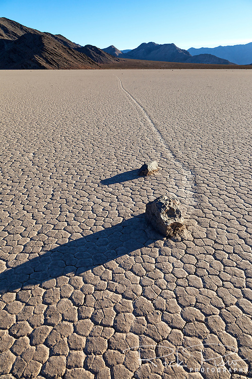 The trail left by a pair of sailing rocks on the Racetrack Playa in Death Valley National Park is evidence of the rocks motion across the playa. The Racetrack Playa is known for its 'sailing stones' which are rocks that mysteriously move across its surface.