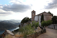 Church of Santa Maria de Siurana, 12th century, Cornudella de Montsant, Priorat, Tarragona, Spain. The Romanesque church has a nave terminating in a plain rounded apse, and a bell tower. The village and the church are perched upon a cliff above the waters of the Siurana river. Picture by Manuel Cohen