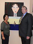 Chairperson of Louth County Council Finan McCoy pictured with local artist Olivia McCoy at her exhibition as part of the Turfman festival. Photo: Colin Bell/pressphotos.ie