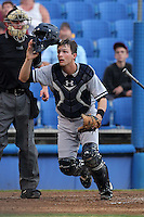 Tampa Yankees catcher J.R. Murphy #30 looks for a foul pop up in front of umpire Brett Terry during a game against the Dunedin Blue Jays at Dunedin Stadium on April 28, 2012 in Dunedin, Florida.  Dunedin defeated the Yankees 6-1.  (Mike Janes/Four Seam Images)