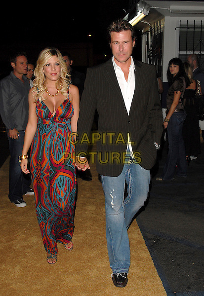"TORI SPELLING & DEAN McDERMOTT.attends Mark Burnett & AOL's Launch of ""Gold Rush"" interactive reality competition held at Les Deux in Hollywood, California, USA, September 12th 2006..full length holding hands orange green pink patterned print dress.Ref: DVS.www.capitalpictures.com.sales@capitalpictures.com.©Debbie VanStory/Capital Pictures"
