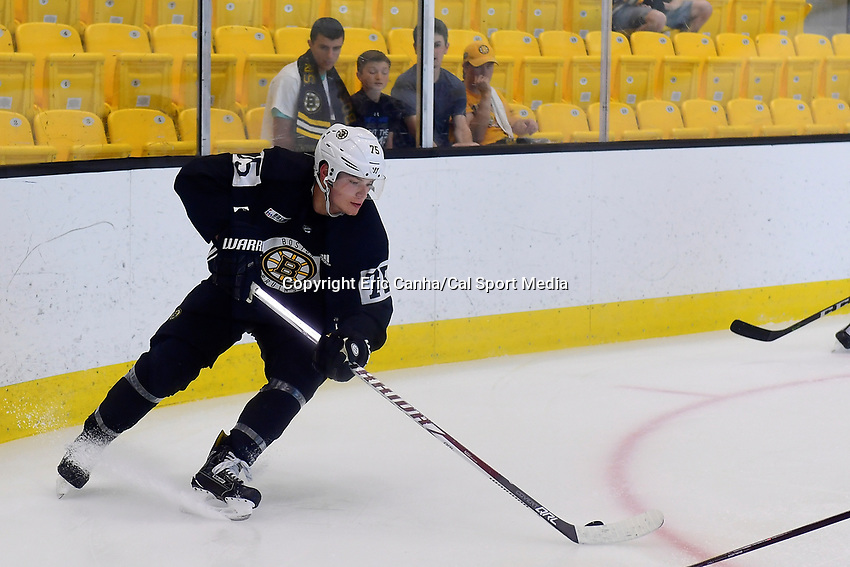 June 29, 2018: Boston Bruins forward Henry Bowlby (75) plays the puck in the corner during a scrimmage at the Boston Bruins development camp held at Warrior Ice Arena in Brighton Mass. Eric Canha/CSM