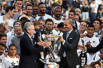 07 December 2014: MLS Commissioner Don Garber hands the Philip F. Anschutz Trophy to Lo Angeles Galaxy owner Philip F. Anschutz. The Los Angeles Galaxy played the New England Revolution in Carson, California in MLS Cup 2014. Los Angeles won 2-1 in overtime.