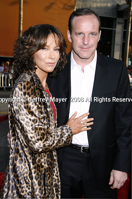 "Actress Jennifer Grey and Actor Clark Gregg arrive to the ""Iron Man"" premiere at Grauman's Chinese Theatre on April 30, 2008 in Hollywood, California."