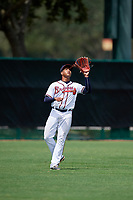 GCL Braves left fielder Charles Reyes (11) settles under a fly ball during the second game of a doubleheader against the GCL Yankees West on July 30, 2018 at Champion Stadium in Kissimmee, Florida.  GCL Braves defeated GCL Yankees West 5-4.  (Mike Janes/Four Seam Images)