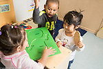 Education Preschool Head Start Early Learn 2s program two girls and a boy interacting over puzzle