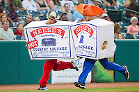 The Neese's Country Sausage race entertains fans between innings of the South Atlantic League game between the Lakewood BlueClaws and the Greensboro Grasshoppers at NewBridge Bank Park on August 18, 2012 in Greensboro, North Carolina.  The Grasshoppers defeated the BlueClaws 9-4.  (Brian Westerholt/Four Seam Images)