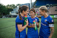 Seattle, WA - Saturday, July 02, 2016: Seattle Reign FC defender Kendall Fletcher (13), Seattle Reign FC forward Nahomi Kawasumi (36) and Seattle Reign FC midfielder Jessica Fishlock (10) after a regular season National Women's Soccer League (NWSL) match between the Seattle Reign FC and the Boston Breakers  at Memorial Stadium.