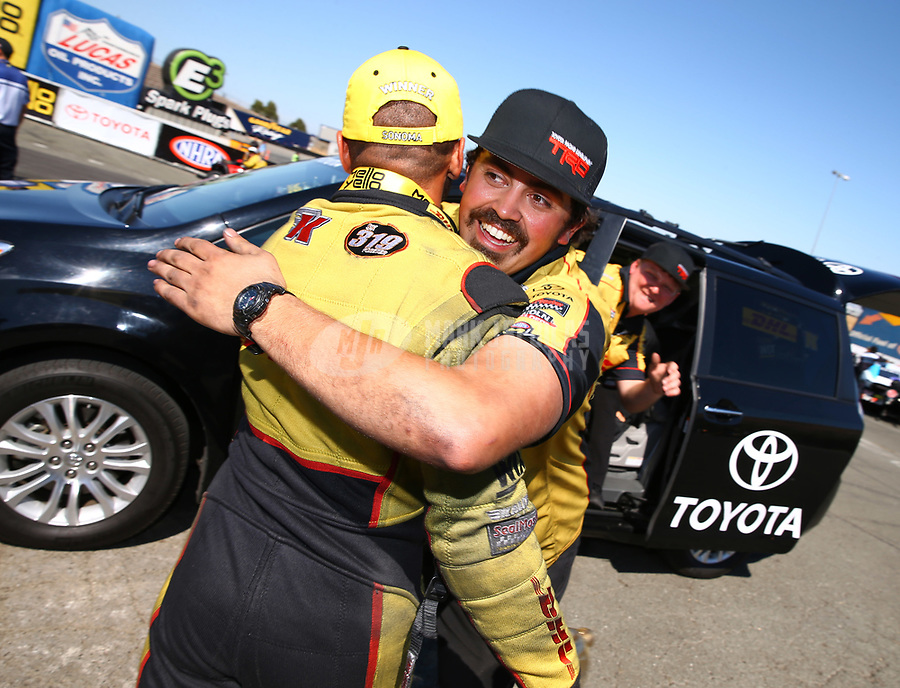 Jul 30, 2017; Sonoma, CA, USA; NHRA funny car driver J.R. Todd celebrates with crew after winning the Sonoma Nationals at Sonoma Raceway. Mandatory Credit: Mark J. Rebilas-USA TODAY Sports