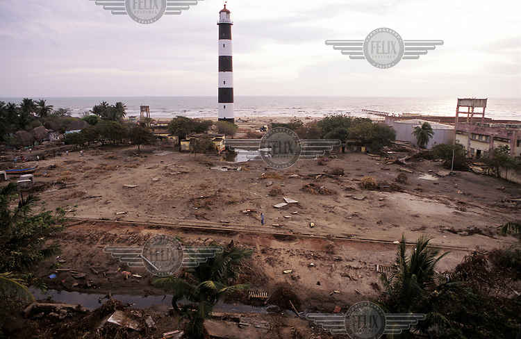 A lighthouse is all that remains standing amidst a scene of devastation following the tsunami which struck South Asia on 26/12/2004..An underwater earthquake measuring 9 on the Richter scale triggered a series of tidal waves which caused devastation when they struck dry land. 12 countries were affected by the tsunami, with a combined death toll of over 150,000.