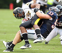 Southern Miss Golden Eagles wide receiver Markese Triplett (23) is tackles by Virginia Cavaliers linebacker Steve Greer (53) during the game at Scott Stadium. Virginia was defeated 30-24. (Photo/Andrew Shurtleff)