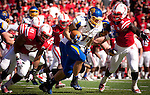 LINCOLN, NE - SEPTEMBER 21, 2013: Zach Zenner of South Dakota State rushes for a first down around Nebraska defenders David Santos #41 and Jason Ankrah #9 in the first half of their game at Memorial Statium in Lincoln, NE. (Photo By Ty Carlson/Inertia)