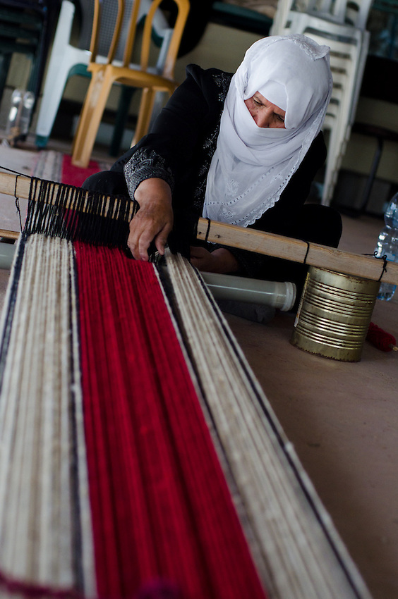 A Bedouin woman using traditonal techniques works at the Sidreh weaving co-operative in Lakiya, Israel. The co-op provides jobs to local women, and uses its profits to support women's literacy and health projects in Bedouin villages in the Negev desert.