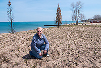 Kim Gledhill and City of Sarnia's Patti Ross at the site of a grass fire on the dunes of Canatara Park beach.