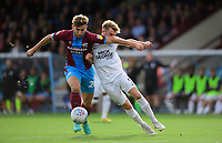 Scunthorpe United's Charlie Goode shields the ball from Peterborough United's Matthew Godden<br /> <br /> Photographer Chris Vaughan/CameraSport<br /> <br /> The EFL Sky Bet League One - Scunthorpe United v Peterborough United - Saturday 13th October 2018 - Glanford Park - Scunthorpe<br /> <br /> World Copyright &copy; 2018 CameraSport. All rights reserved. 43 Linden Ave. Countesthorpe. Leicester. England. LE8 5PG - Tel: +44 (0) 116 277 4147 - admin@camerasport.com - www.camerasport.com