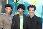 UNIVERSAL CITY, CA. - August 09: Singers Nick Jonas, Joe Jonas, and Kevin Jonas of the Jonas Brothers arrives at the Teen Choice Awards 2009 held at the Gibson Amphitheatre on August 9, 2009 in Universal City, California.