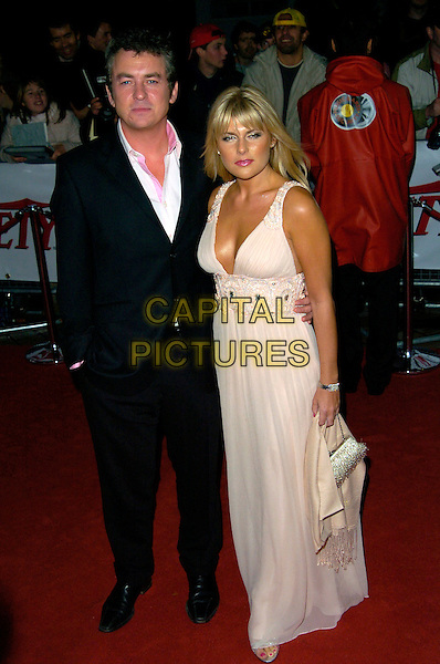 SHANE RICHIE & CHRISTIE GODDARD.National Movie Awards, Royal Festival Hall, London, England..September 28th, 2007.full length black suit jacket hand in pocket pink dress .CAP/CAN.©Can Nguyen/Capital Pictures