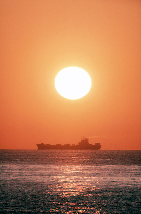 Container ship at sunset, Pacific Ocean, off Washington State Coast,
