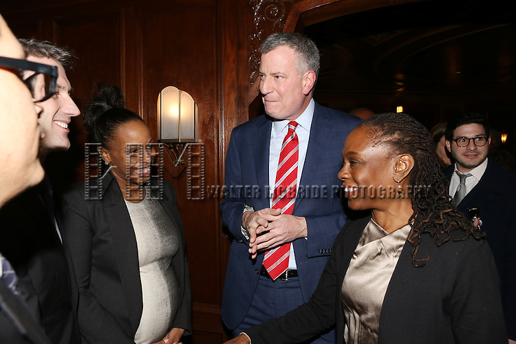 Mayor Bill de Blasio and wife Chirlane McCray attending the Kings Theatre Re-Opening in Flatbush, Brooklyn on February 3, 2015 in New York City. <br /> A once gilded Brooklyn movie palace that's been crumbling for decades, with pigeons infesting its stage, is back - again a glittering gem from the 1920s.<br /> Diana Ross headlines the opening night at the 3,200-seat Kings Theatre  where a teenage Barbra Streisand spent afternoons enjoying double-features.<br /> After a two-year, $95 million renovation, every detail from its jazz age 1929 incarnation has come to life amid computerized sound and LED lighting. The theater that first opened weeks before the Wall Street crash is now the largest in New York's biggest borough.