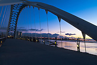 A view of the Toronto skyline at dawn with the Humber Bay Arch Bridge in the foreground