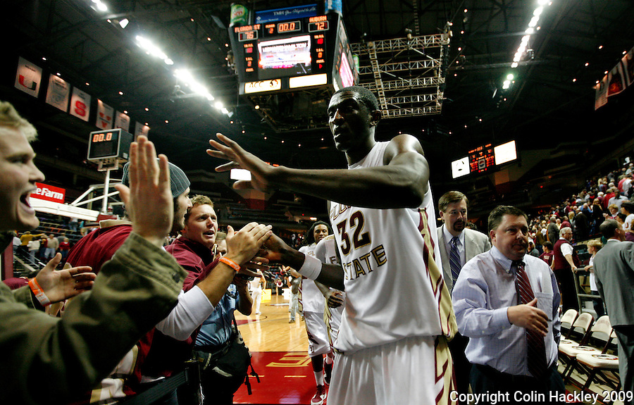 TALLAHASSEE, FL 12/11/09-FSU-AU BB09 CH38-Florida State's Solomon Alabi celebrates with fans after the Auburn game Thursday at the Donald L. Tucker Center in Tallahassee. The Seminoles beat the Tigers 76-72...COLIN HACKLEY PHOTO