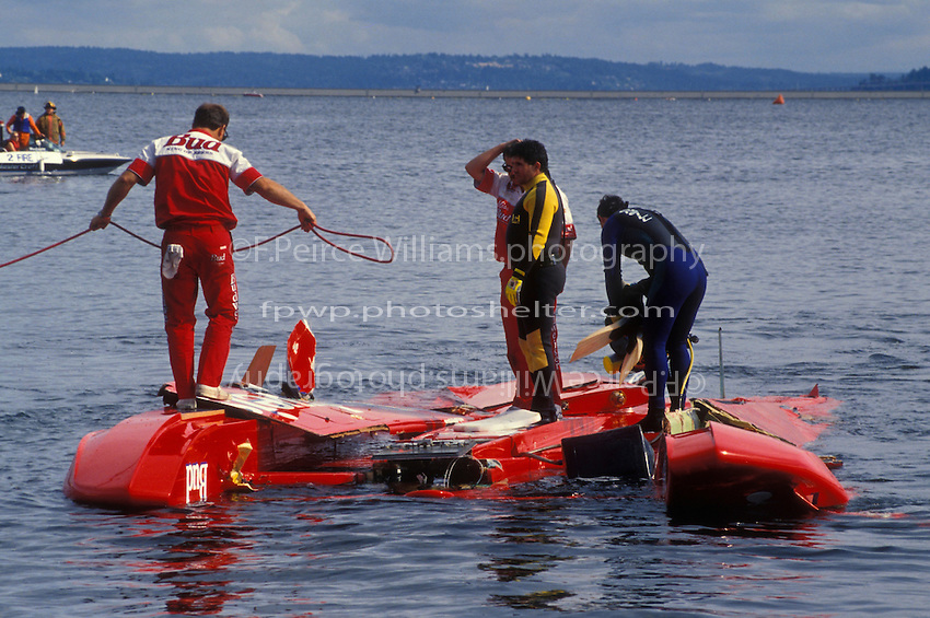 """The Budweiser crew brings the remains of the U-1 """"Miss Budweiser T-3"""" to shore."""