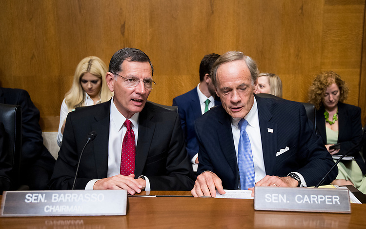 UNITED STATES - AUGUST 1: From left, chairman John Barrasso, R-Wyo., and ranking member Tom Carper, D-Del., talk before the start testimony from Andrew Wheeler,<br /> acting administrator at the Environmental Protection Agency, prepares to testify during the Senate Committee on Environment and Public Works hearing on &ldquo;Examining EPA&rsquo;s Agenda: Protecting the Environment and Allowing America&rsquo;s Economy to Grow&rdquo; on Wednesday, Aug. 1, 2018.  (Photo By Bill Clark/CQ Roll Call)