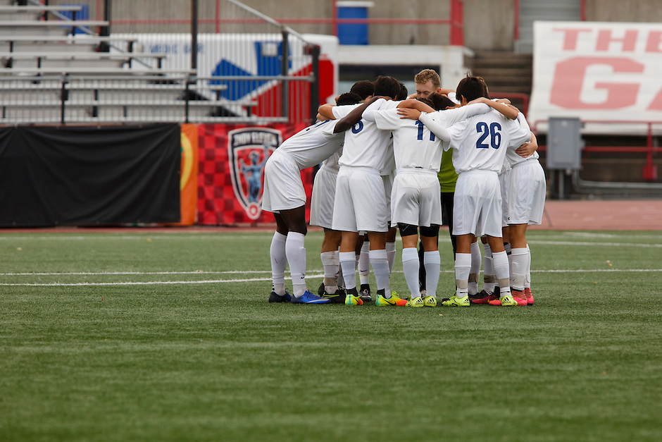 Mishawaka Marian players huddle up before the IHSAA Class A Boys Soccer State Championship Game against Providence on Saturday, Oct. 29, 2016, at Carroll Stadium in Indianapolis. Marian won 4-0. Special to the Tribune/JAMES BROSHER
