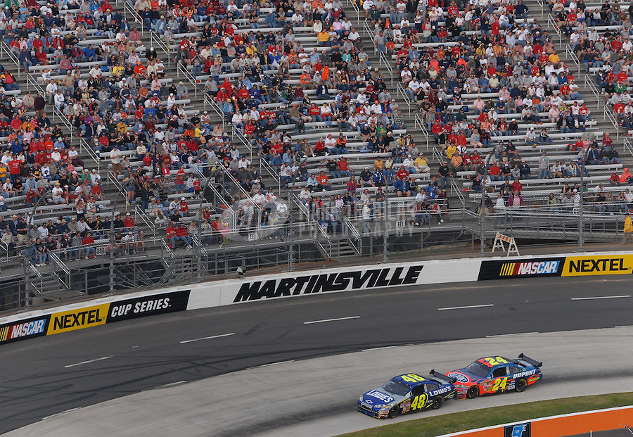 Apr 1, 2007; Martinsville, VA, USA; Nascar Nextel Cup Series driver Jimmie Johnson (48) leads teammate Jeff Gordon (24) during the Goody's Cool Orange 500 at Martinsville Speedway. Martinsville marks the second race for the new car of tomorrow. Mandatory Credit: Mark J. Rebilas