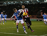 Leon Clarke of Sheffield Utd tussles with Joe Edwards of Walsall during the English League One match at Bramall Lane Stadium, Sheffield. Picture date: November 29th, 2016. Pic Simon Bellis/Sportimage