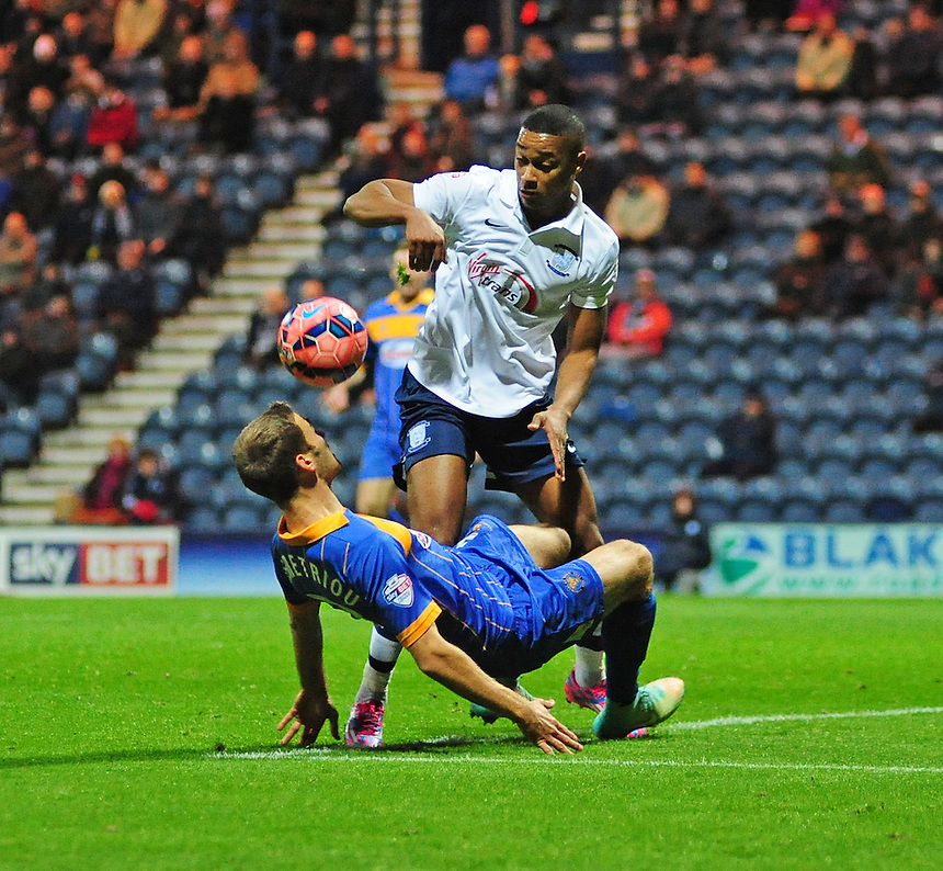Preston North End's Chris Humphrey vies for possession with Shrewsbury Town's Mickey Demetriou<br /> <br /> Photographer Chris Vaughan/CameraSport<br /> <br /> Football - FA Challenge Cup Second Round - Preston North End v Shrewsbury Town - Saturday 6th December 2014 - Deepdale - Preston<br /> <br />  &copy; CameraSport - 43 Linden Ave. Countesthorpe. Leicester. England. LE8 5PG - Tel: +44 (0) 116 277 4147 - admin@camerasport.com - www.camerasport.com