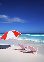 Red beach chairs and umbrella, vertical