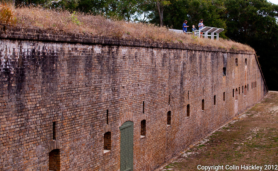 Fort Barrancas visitors stand on the edge of the counterscarp, the rear defenses of the installation.<br /> <br /> COLIN HACKLEY PHOTO