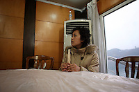 CHINA. Chongqing Province.  A woman on a boat passing through the 3 Gorges. The flooding of the three Gorges, by damming the Yangtze near the town of YiChang, has remained a controversial subject due to the negative environmental consequences and the displacement of millions of people in the flood plain. The Yangtze River however is reported to be at its lowest level in 150 years as a result of a country-wide drought. It is China's longest river and the third longest in the world. Originating in Tibet, the river flows for 3,964 miles (6,380km) through central China into the East China Sea at Shanghai.  2008.