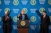 United States President Donald J. Trump, joined by Vice President Mike Pence (L) and Energy Secretary Rick Perry, delivers remarks at the Unleashing American Energy event at the Department of Energy in Washington, D.C. on June 29, 2017. <br /> Credit: Kevin Dietsch / Pool via CNP