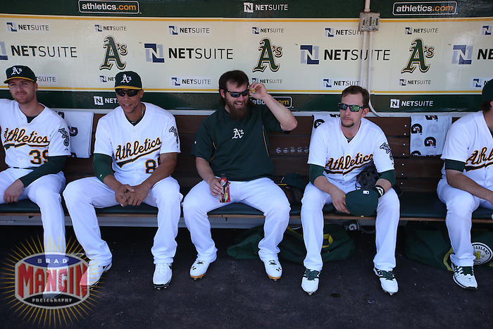 OAKLAND, CA - JUNE 1:  Kyle Blanks, Derek Norris, and Jed Lowrie of the Oakland Athletics sits in the dugout before the game against the Los Angeles Angels of Anaheim at O.co Coliseum on Sunday, June 1, 2014 in Oakland, California. Photo by Brad Mangin