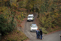 Pictured: Police at the entrance to the track leading to the house that burned in Llangammarch Wells, Powys, Wales, UK. Tuesday 31 October 2017<br /> Re: Investigations continue into a house fire in which a father and several of his children have died.<br /> Three children aged 13, 12 and 10 escaped the farmhouse in Llangammarch Wells, Powys, in the early hours of Monday and raised the alarm.<br /> Police said they could not identify the deceased or confirm numbers.<br /> One of those missing has been named locally as David Cuthbertson.