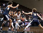 SIOUX FALLS, SD - MARCH 10:   Keun Palu-Thompson #2 from the College of Idaho tries to split the defense of Reginald Kissoonlal #5 and Christian Stewart #30 from Marian during their quarterfinal game at the 2018 NAIA DII Men's Basketball Championship at the Sanford Pentagon in Sioux Falls. (Photo by Dave Eggen/Inertia)