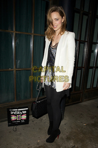 Melissa George.The InStyle Best Of British Talent party, Shoreditch House, Ebor St., London, England..January 26th, 2012.full length black coat jacket white tights blazer sheer bag purse grey gray dress.CAP/PP/CB.©Cliff Bass/People Press/Capital Pictures