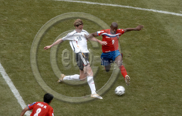 """MUNICH - GERMANY 09. JUNE 2006 -- FIFA World Cup 2006 - The opening match - Germany against Costa Rica 4-2 - BOROWSKI Tim (GER) and WANCHOPE Paulo (CRC) -- PHOTO: CHRISTIAN T. JOERGENSEN / EUP & IMAGES..This image is delivered according to terms set out in """"Terms - Prices & Terms"""". (Please see www.fotofactory.dk for more details)"""