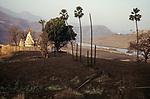 INDIA, state Gujarat, Narmada river and dams, reservoir of Narmada dam Sardar Sarovar Project at tribal village Manibeli, submerged farm land and old Shoolpaneshwar Mahadev hindu temple, remained mud after first submergence 1993, today the temple is permanently under water / INDIEN, Gujerat, Narmada Fluss und Staudaemme, Stausee des Sardar Sarovar Projekt Staudamm, ueberflutetes Ackerland und Hindu Tempel des Adivasi Dorf Manibeli