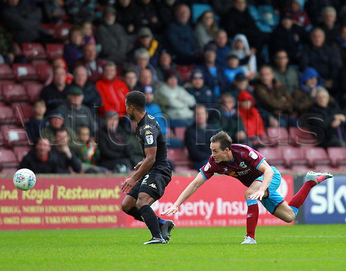 7th October 2017, Glanford Park, Scunthorpe, England; EFL League One football, Scunthorpe versus Wigan; Josh Morris of Scunthorpe United is takled by Nathan Byrne of Wigan Athletic in the 1-2 loss