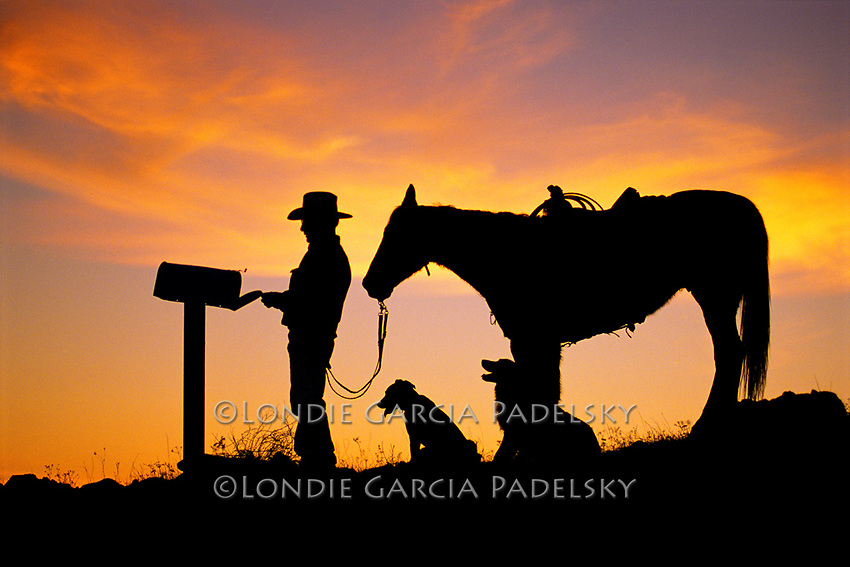 Cowboy getting the mail at sunset. San Luis Obispo, California