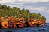 Sea caves formed by erosion of sandstone cliffs on the shoreline of Devils Island in the Apostle Islands National Lakeshore. Bayfield Wisconsin USA Lake Superior.