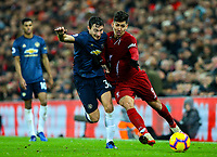 Liverpool's Roberto Firmino vies for possession with Manchester United's Matteo Darmian<br /> <br /> Photographer AlexDodd/CameraSport<br /> <br /> The Premier League - Liverpool v Manchester United - Sunday 16th December 2018 - Anfield - Liverpool<br /> <br /> World Copyright © 2018 CameraSport. All rights reserved. 43 Linden Ave. Countesthorpe. Leicester. England. LE8 5PG - Tel: +44 (0) 116 277 4147 - admin@camerasport.com - www.camerasport.com