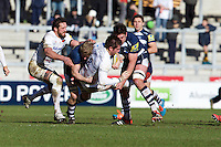21.02.2015.  Sale, England.  Aviva Premiership Rugby. Sale Sharks versus Saracens. Saracens flanker Jackson Wray is tackled by Sale Sharks lock Nathan Hines.