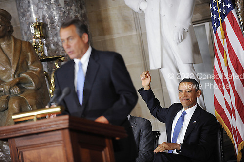 Speaker of the United States House John Boehner (Republican of Ohio) speaks as U.S. President Barack Obama gestures during the unveiling of a statue of Rosa Parks in Statuary Hall of the United States Capitol February 27, 2013 in Washington, DC. .Credit: Olivier Douliery / Pool via CNP
