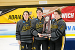 ADRIAN, MI - MARCH 18: Adrian College is presented the runner-up trophy after the Division III Women's Ice Hockey Championship held at Arrington Ice Arena on March 19, 2017 in Adrian, Michigan. Plattsburgh State defeated Adrian 4-3 in overtime to repeat as national champions for the fourth consecutive year. by Tony Ding/NCAA Photos via Getty Images)